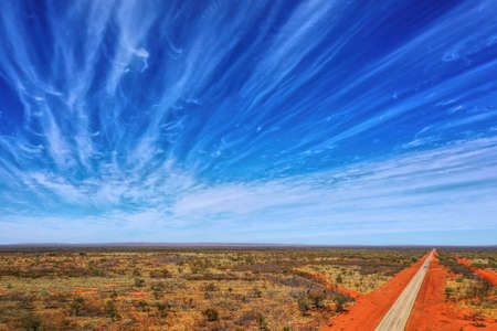 Travelling through Central Australia with awesome cloud formation Stock fotó