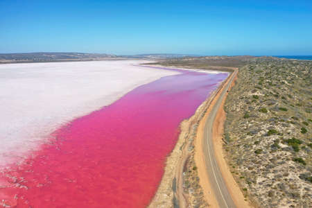 Hutt Lagoon is between Geraldton and Kalbarri Western Australia. Lake turns pink from algae with red pigments.