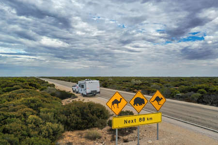 Aerial view of outback Australia travelling on the road with a caravan and 4wd 스톡 콘텐츠