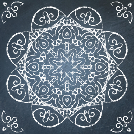 Round filigree hand drawn ornament on chalkboard
