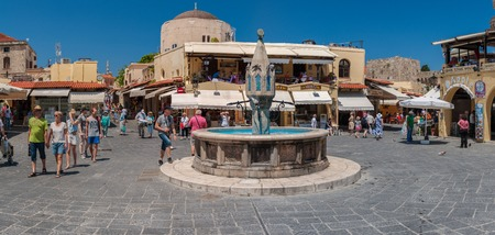 hippocrates: RHODES, GREECE - May 21, 2015: Tourists on Hippocrates square at the Old Town of Rhodes, Greece
