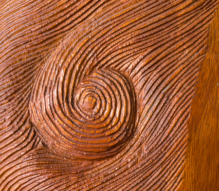 red handed: Handed Carved Whirl Red Wood Texture Background