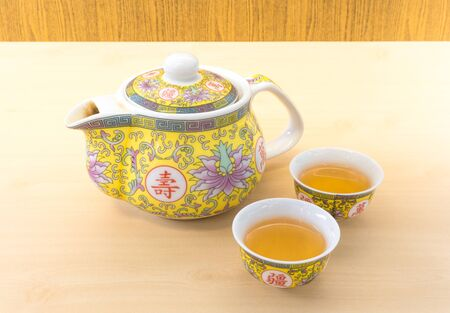 yellow tea pot: Chinese Tea Pot Set with Two Small Tea Cup Stock Photo