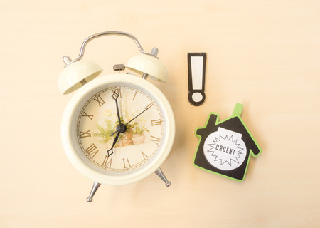 White Clock with Alert and Urgent Sign Stock Photo