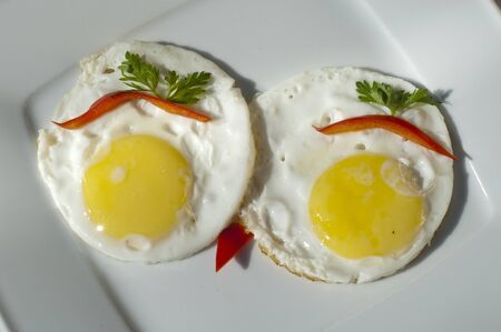 food. Fried eggs, red peppers, parsley, breakfast, a white plate