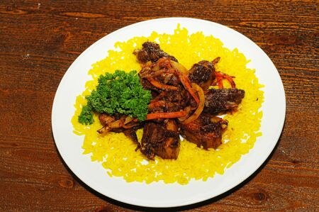 Rice yellow ribs of mutton, roasted peppers, carrots, onions, photo
