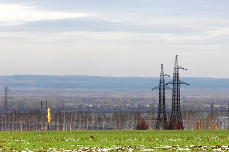 Power poles, standing in a field Stock Photo - 14329135