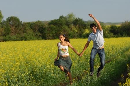 Love story. Running along the river, splashing