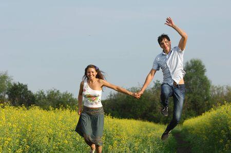 Love story  Running along the river, splashing Stock Photo
