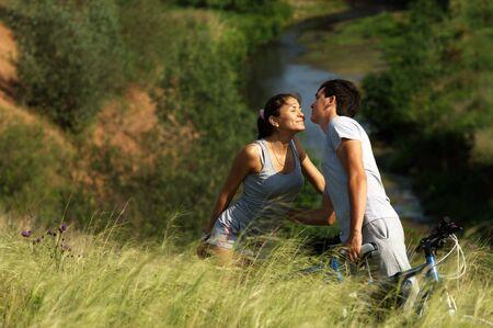 Love story  Running along the river, splashing photo