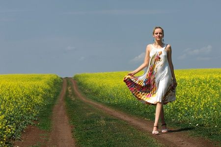 The girl in the rapeseed field, summer mood photo