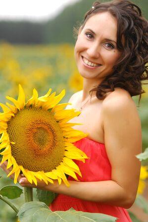 Girl with a sunflower, yellow flower, high spirits photo