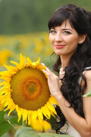 Girl with a sunflower, yellow flower, high spirits photo
