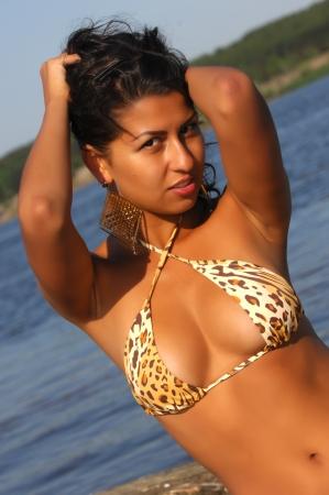 Girl on the beach, bright sun, good mood