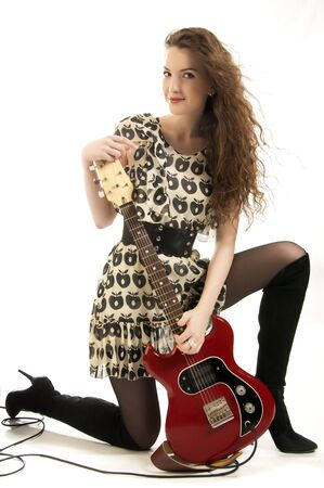 The girl with a guitar. Photographed in the studio photo