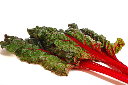 beet leaves. closeup of a backlit mangold leaf. fresh vegetables - spinach beet isolated on the white background.  Stock Photo