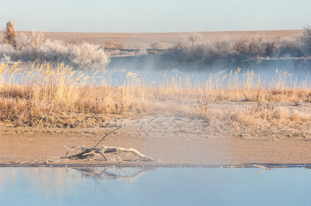 River in late autumn. A landscape photo in late autumn. sunrise over the river late autumn. winter landscape of southern Kazakhstan photo