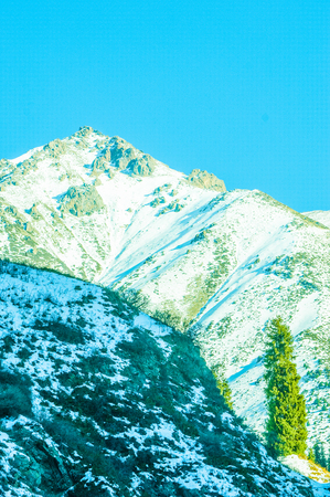 frosty morning: Kazakhstan. Tien Shan. Beautiful landscape with mountain views. Winter evening.