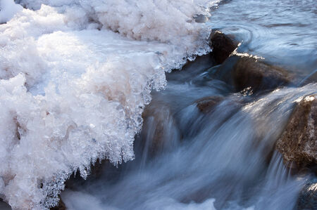 coldness: River ice. river in winter. winter creek.