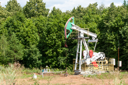oney: Work of oil pump jack on a oil field. Stock Photo