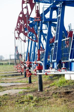 oney:  Work of oil pump jack on a oil field.