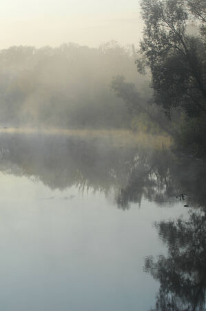 Autumn fog sunrise. Autumn fog and the beautiful morning sun in a landscape. Beautiful autumn dawn. Autumn fog at misty fields. photo