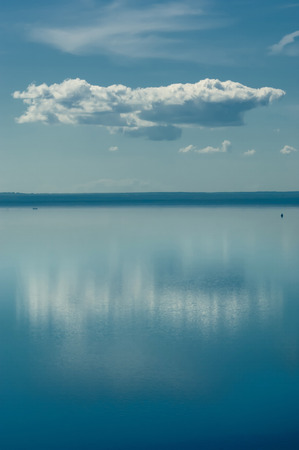 The river and the cloud.   On the river is calm now. Beautiful clouds are reflected in quiet water.