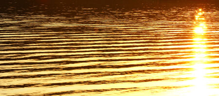 texture of water.sunset, sunrise, sun reflected in water Stock Photo