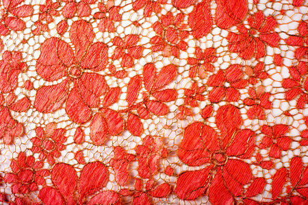 especially: texture lace. a fine open fabric, typically one of cotton or silk, made by looping, twisting, or knitting thread in patterns and used especially for trimming garments. Stock Photo