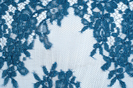 looping: texture lace. a fine open fabric, typically one of cotton or silk, made by looping, twisting, or knitting thread in patterns and used especially for trimming garments. Stock Photo