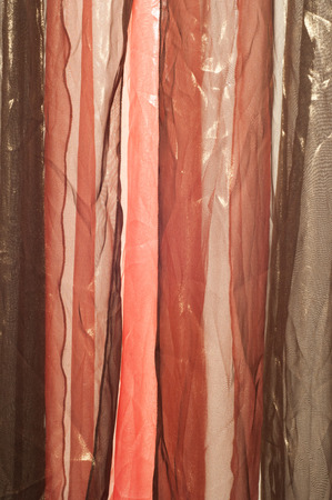 Pink brown transparent fabric. texture.  Photographed in the studio photo