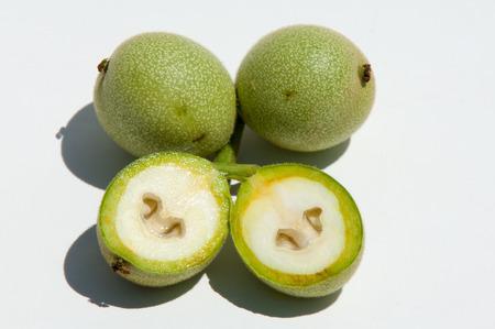 unripe walnuts. walnut. Photographed in the studio