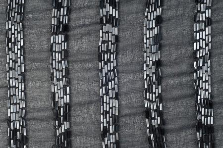 ebon: Tela en color negro con cuentas. Fotograf�a de estudio. textura. �bano, sable, tiznado. del color muy oscuro debido a la ausencia o la absorci�n completa de la luz; lo contrario de blanco