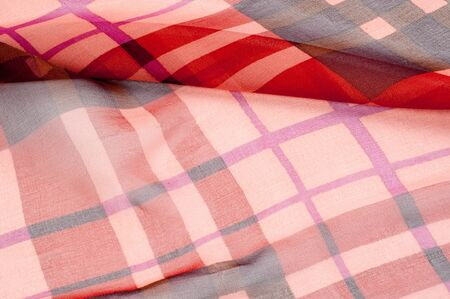 chequered drapery: Silk fabric texture. red cell.   Photography Studio