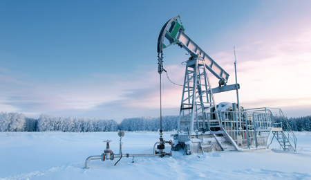 dominating: rocking oil. Oil pumps. Oil industry equipment. wheat field Stock Photo