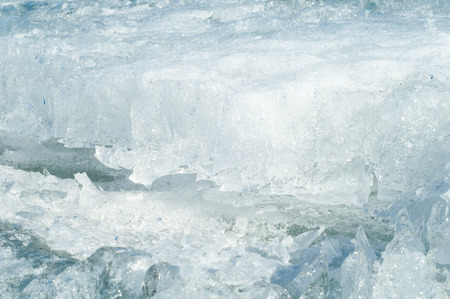 interstice: texture.  ice. Frozen ice on the river.