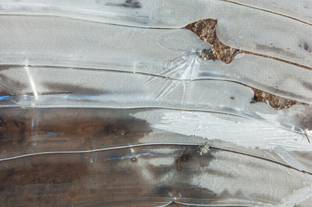 mud snow: texture.  Frozen puddle, spring, ice patterns. Stock Photo