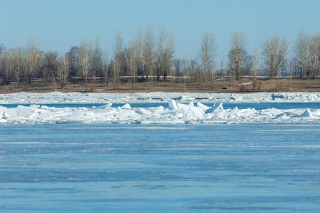 River flood. Torn river ice. River with the last ice. Russia Tatarstan Kama river in early spring photo