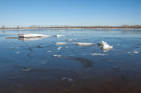 crevasse: River With Broken Ice. energy pillars.  ice hummocks on the river in spring. landscape close-up ice drift on the river in the spring on a sunny day Stock Photo