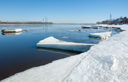 River With Broken Ice.   ice hummocks on the river in spring. landscape close-up ice drift on the river in the spring on a sunny day photo