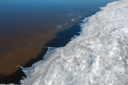 Spring flooding, ice water, Early spring on the river. Russia Tatarstan Kama river in early spring photo