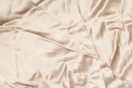 lustrous: Fabric silk texture, brown. a fine, strong, soft, lustrous fiber produced by silkworms in making cocoons and collected to make thread and fabric