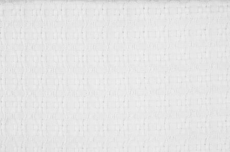 woolen cloth: texture of white woolen cloth. Background or texture of white fabric closeup.