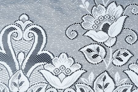 derived: Fabric texture tulle. Tulle Lace   border pattern. Tulle is a type of netting derived from nylon, rayon or silk. Stock Photo