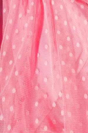 hot pink: The texture of fabric lace with sequins on fabric background. a small, shiny disk sewn as one of many onto clothing for decoration. Magenta, Hot pink, Cerise Stock Photo