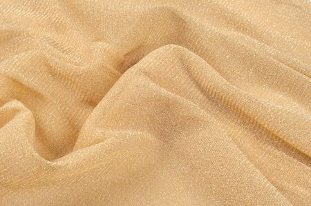 gold flax: The texture of the silk fabric of beige color. Almond