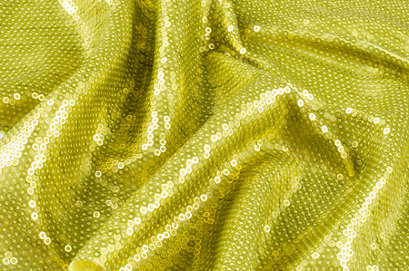 as one: Fabric texture with green sequins. a small, shiny disk sewn as one of many onto clothing for decoration Stock Photo