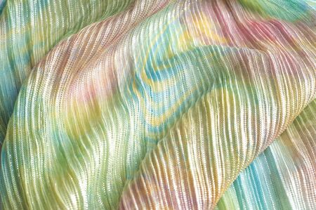 pleated: Pleated fabric with colorful abstract drawings. Full frame take of a pleated fabric with a casual, hippie like pattern Stock Photo