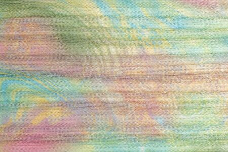 gauzy: Pleated fabric with colorful abstract drawings. Full frame take of a pleated fabric with a casual, hippie like pattern Stock Photo