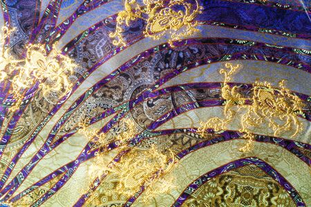 trimming: texture lace. a fine open fabric, typically one of cotton or silk, made by looping, twisting, or knitting thread in patterns and used especially for trimming garments. Stock Photo